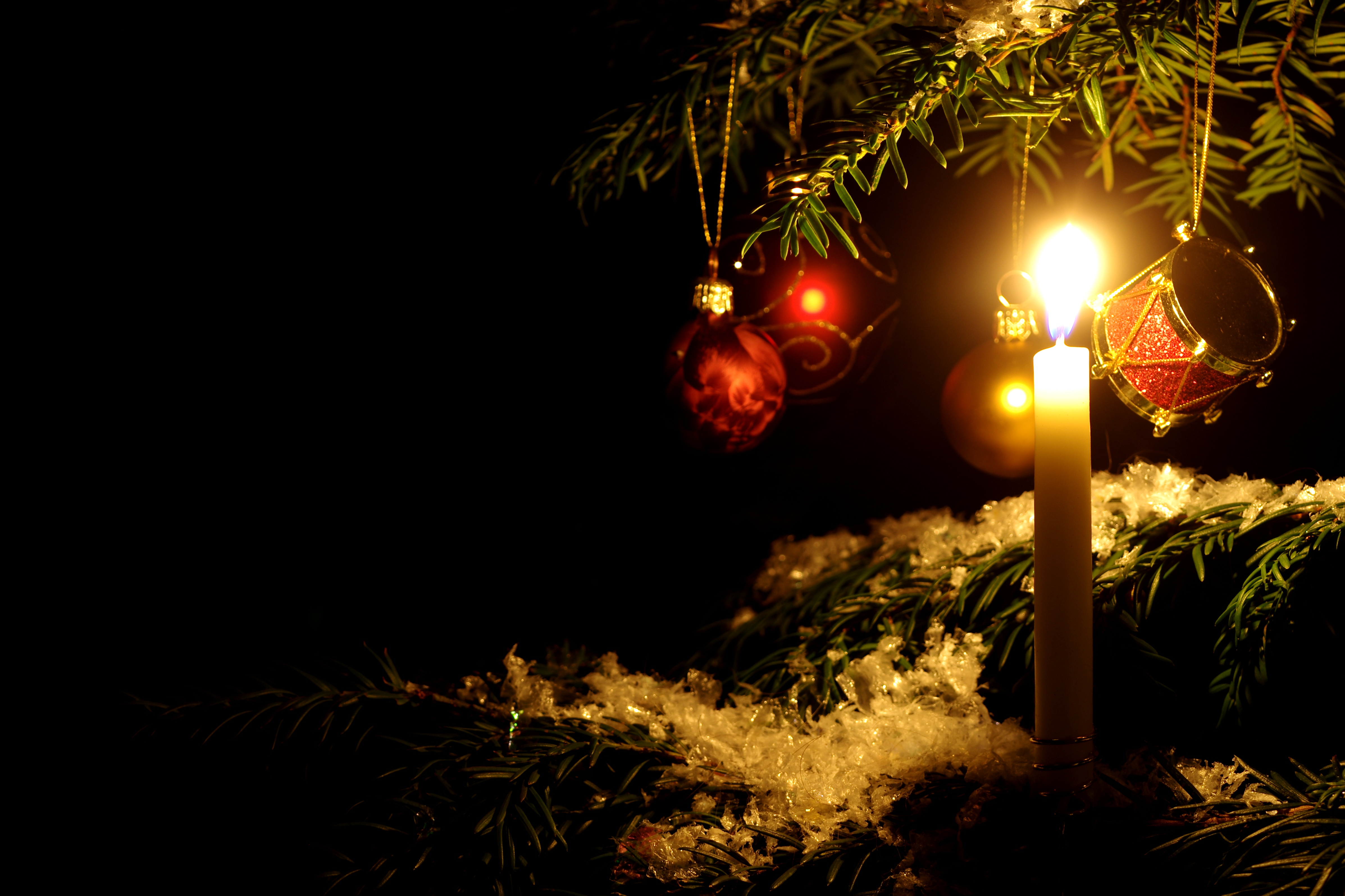 christmas ornament lit by candle