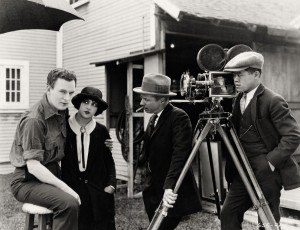 pictured: Thomas Meighan, Estelle Taylor, Herbert Brenon (director) and James Wong Howe (cinematographer) on the set of The Alaskan - Paramount Pictures