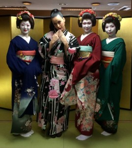 Katy Perry poses with Geishas