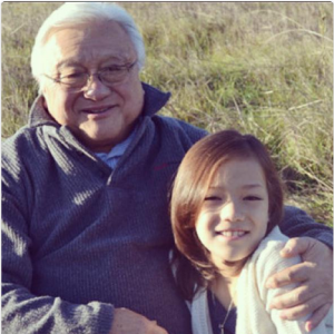 Mike Honda and grandchild Malisa