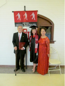 Chinh Doan at College graduation with parents
