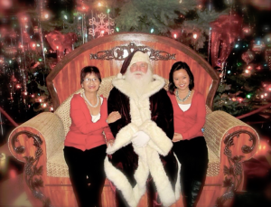 Chinh Doan and mom with Santa Claus in America