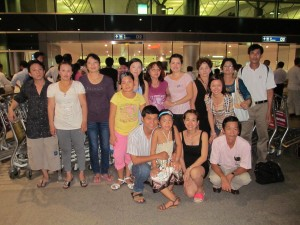 Chinh Doan with family at airport before leaving for America