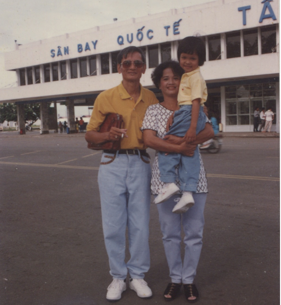 Chinh Doan with parents at airport