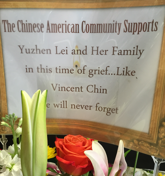Flowers placed at the scene of the murder by a Southern California man for  Yuzhen Lei