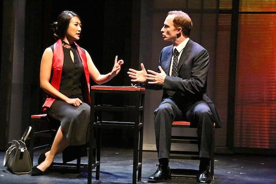 Xi Yan, Vice Minister of Culture, played by Kara Wang, explains a situation to American businessman Daniel Cavanaugh, played by Matthew Jaeger in East West Players production of David Henry Hwang's 'Chinglish'. Photo by Michael Lamont