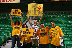 Warrior Fans hold up We Believe signs created by Paul Wong