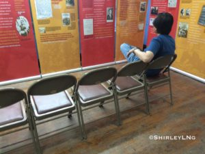 Corky Lee relaxes after assembling The Chinese Exclusion Act exhibit.