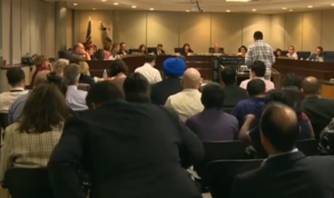 200 people pack a hearing to discuss changes in history books used in California
