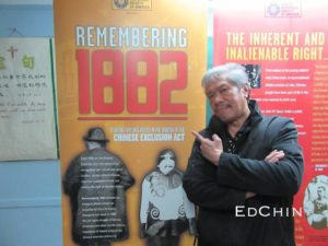 Karlin Chan poses with the 1882 Chinese Exclusion Act traveling exhibit in Manhattan's Chinatown in May 2016.