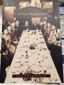 Andy Toy's family legacy is featured in this book. His great grand father is seated at the head of the table.