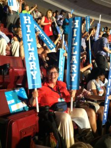 Anastasia Walsh is a happy camper with her Hillary signs at the DNC.