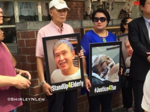 Marchers hold before and after images of Mr. Tse.