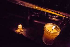 Police tape and candle