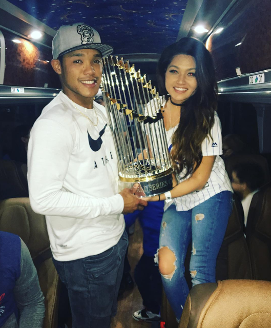 Addison and Melisa Russell Hoist World Series Trophy